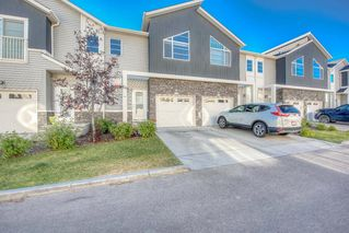 Photo 2: 550 Redstone View NE in Calgary: Redstone Row/Townhouse for sale : MLS®# A1038452