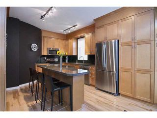"Photo 4: 1715 ARBUTUS Place in Coquitlam: Westwood Plateau House for sale in ""WESTWOOD PLATEAU"" : MLS®# V939721"