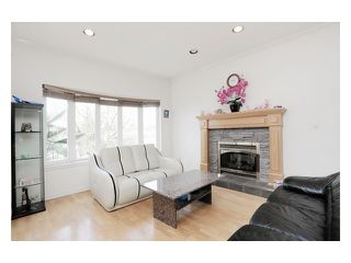 Photo 2: 5518 SHERBROOKE Street in Vancouver: Knight House for sale (Vancouver East)  : MLS®# V943616