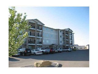 Photo 1: 301 300 EDWARDS Way NW: Airdrie Condo for sale : MLS®# C3572082