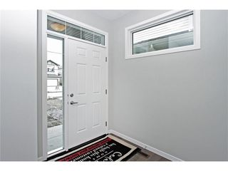 Photo 2: 51 Brightoncrest Point(e) SE in Calgary: New Brighton House for sale : MLS®# C4075751