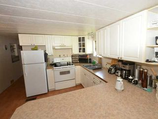 """Photo 5: 37 201 CAYER Street in Coquitlam: Maillardville Manufactured Home for sale in """"WILDWOOD PARK"""" : MLS®# V972709"""