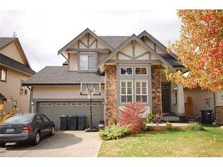 "Photo 1: 82 HAWTHORN Drive in Port Moody: Heritage Woods PM House for sale in ""HERITAGE WOODS"" : MLS®# V1003245"