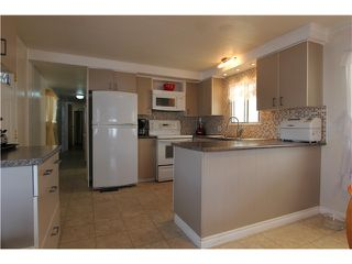 "Photo 1: 288 201 CAYER Street in Coquitlam: Maillardville Manufactured Home for sale in ""WILDWOOD PARK"" : MLS®# V1007219"