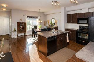 Photo 4: 4469 MCCRAE Avenue in Edmonton: Zone 27 Townhouse for sale : MLS®# E4178542