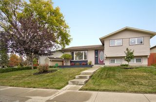 Main Photo: 416 PENBROOKE Crescent SE in Calgary: Penbrooke Meadows Detached for sale : MLS®# A1037491