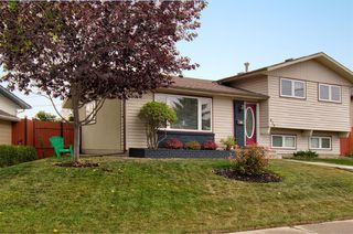 Photo 2: 416 PENBROOKE Crescent SE in Calgary: Penbrooke Meadows Detached for sale : MLS®# A1037491