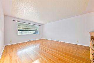 Photo 5: 1028 / 1026 39 Avenue NW in Calgary: Cambrian Heights Duplex for sale : MLS®# A1050074