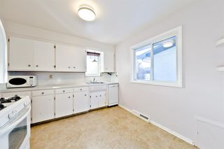 Photo 11: 1028 / 1026 39 Avenue NW in Calgary: Cambrian Heights Duplex for sale : MLS®# A1050074