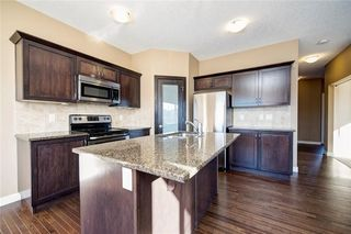 Photo 14: 482 WILLIAMSTOWN GR NW: Airdrie House for sale : MLS®# C4172296