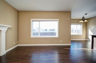 Photo 8: 482 WILLIAMSTOWN GR NW: Airdrie House for sale : MLS®# C4172296