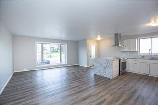 Photo 5: 59 EMBERDALE Way SE: Airdrie Detached for sale : MLS®# C4305530