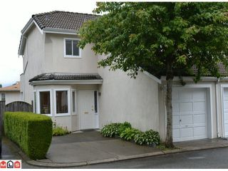 "Photo 1: 1 10062 154TH Street in SURREY: Guildford Townhouse for sale in ""WOODLAND GROVE"" (North Surrey)  : MLS®# F1215581"