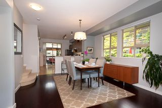 """Photo 1: 120 100 KLAHANIE Drive in Port Moody: Port Moody Centre Townhouse for sale in """"INDIGO"""" : MLS®# R2480880"""
