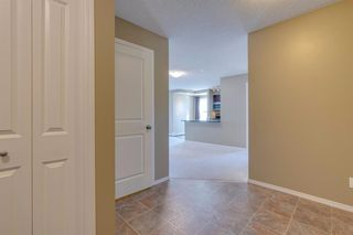 Photo 3: 9302 403 MACKENZIE Way SW: Airdrie Apartment for sale : MLS®# A1032027