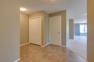 Photo 4: 9302 403 MACKENZIE Way SW: Airdrie Apartment for sale : MLS®# A1032027