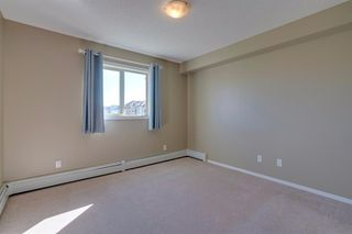 Photo 17: 9302 403 MACKENZIE Way SW: Airdrie Apartment for sale : MLS®# A1032027