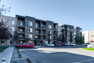 Photo 1: 9302 403 MACKENZIE Way SW: Airdrie Apartment for sale : MLS®# A1032027