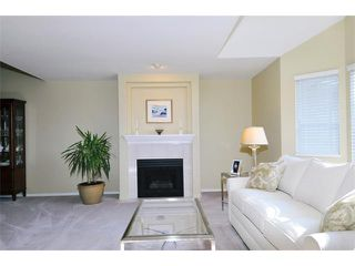 "Photo 2: 149 101 PARKSIDE Drive in Port Moody: Heritage Mountain Townhouse for sale in ""TREETOPS"" : MLS®# V994969"