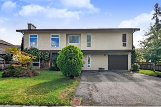 Photo 1: 20910 51 Avenue in Langley: Langley City House for sale : MLS®# R2408191