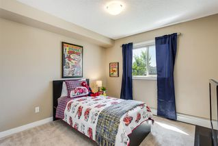 Photo 15: 4201 403 MACKENZIE Way SW: Airdrie Apartment for sale : MLS®# A1015436