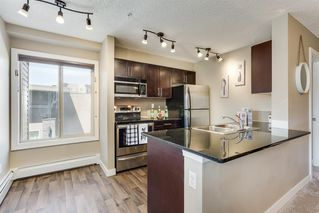 Photo 6: 4201 403 MACKENZIE Way SW: Airdrie Apartment for sale : MLS®# A1015436