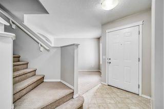 Photo 4: 341 SADDLECREST Way NE in Calgary: Saddle Ridge Detached for sale : MLS®# A1036499