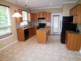 "Photo 2: 6258 135B ST in Surrey: Panorama Ridge House for sale in ""Heritage Woods"" : MLS®# F1312156"