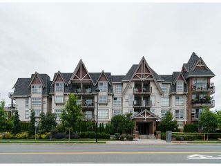 Photo 1: # 218 17769 57TH AV in Surrey: Cloverdale BC Condo for sale (Cloverdale)  : MLS®# F1415783