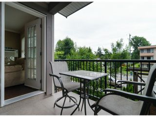 Photo 10: # 218 17769 57TH AV in Surrey: Cloverdale BC Condo for sale (Cloverdale)  : MLS®# F1415783