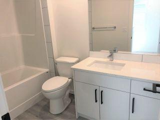 Photo 15: 315 Orchards Boulevard in Edmonton: Zone 53 House Half Duplex for sale : MLS®# E4179751