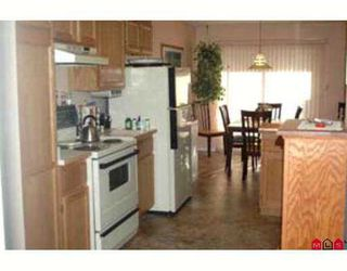 """Photo 6: 110 5641 201ST ST in Langley: Langley City Townhouse for sale in """"HUNTINGTON"""" : MLS®# F2616723"""