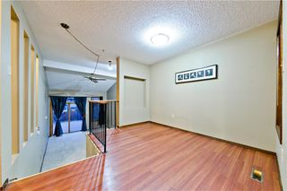 Photo 3: 167 EDGEMONT ESTATES DR NW in Calgary: Edgemont House for sale : MLS®# C4221851