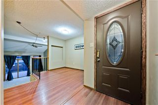 Photo 2: 167 EDGEMONT ESTATES DR NW in Calgary: Edgemont House for sale : MLS®# C4221851