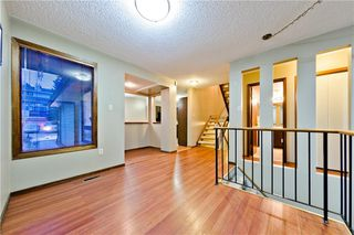 Photo 4: 167 EDGEMONT ESTATES DR NW in Calgary: Edgemont House for sale : MLS®# C4221851