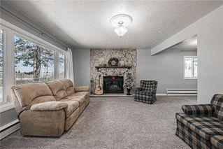 Photo 4: 611 75 Avenue SW in Calgary: Kingsland Detached for sale : MLS®# C4296092
