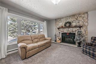 Photo 5: 611 75 Avenue SW in Calgary: Kingsland Detached for sale : MLS®# C4296092