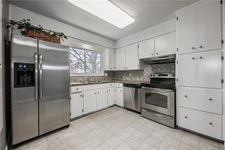 Photo 8: 611 75 Avenue SW in Calgary: Kingsland Detached for sale : MLS®# C4296092