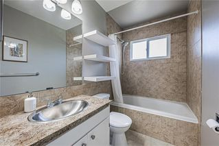 Photo 13: 611 75 Avenue SW in Calgary: Kingsland Detached for sale : MLS®# C4296092
