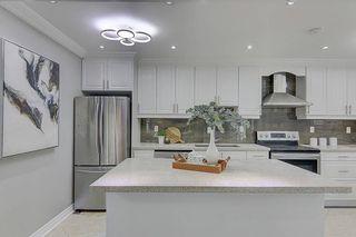 Photo 14: 335 Chester Le Boulevard in Toronto: L'Amoreaux House (Bungalow-Raised) for sale (Toronto E05)  : MLS®# E5069013