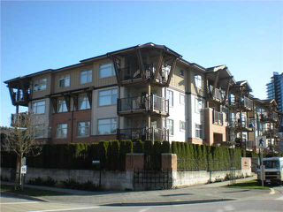 "Photo 1: 104 500 KLAHANIE Drive in Port Moody: Port Moody Centre Condo for sale in ""TIDES"" : MLS®# V939597"