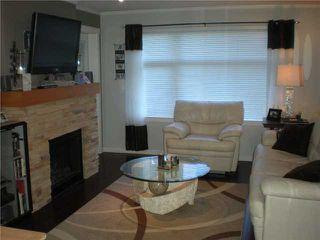 "Photo 2: 104 500 KLAHANIE Drive in Port Moody: Port Moody Centre Condo for sale in ""TIDES"" : MLS®# V939597"