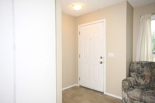 Photo 3: 6 Erin Woods Court SE in Calgary: Erinwoods House for sale : MLS®# C3531056