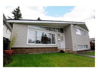 Photo 1: 3376 RALEIGH Street in Port Coquitlam: Woodland Acres PQ House for sale : MLS®# V993541