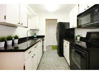 Photo 3: # 108 13507 96TH AV in Surrey: Whalley Condo for sale (North Surrey)  : MLS®# F1417466