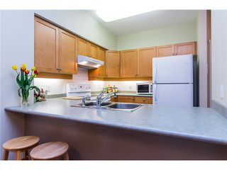 Photo 3: # 108 808 SANGSTER PL in New Westminster: The Heights NW Condo for sale : MLS®# V1130644
