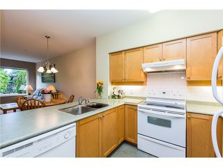 Photo 2: # 108 808 SANGSTER PL in New Westminster: The Heights NW Condo for sale : MLS®# V1130644