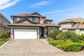 "Photo 1: 6863 183 Street in Surrey: Cloverdale BC House for sale in ""Cloverwoods"" (Cloverdale)  : MLS®# R2394519"