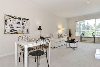 """Photo 4: 334 3098 GUILDFORD Way in Coquitlam: North Coquitlam Condo for sale in """"Marlborough House"""" : MLS®# R2387538"""