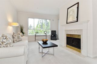 """Photo 1: 334 3098 GUILDFORD Way in Coquitlam: North Coquitlam Condo for sale in """"Marlborough House"""" : MLS®# R2387538"""